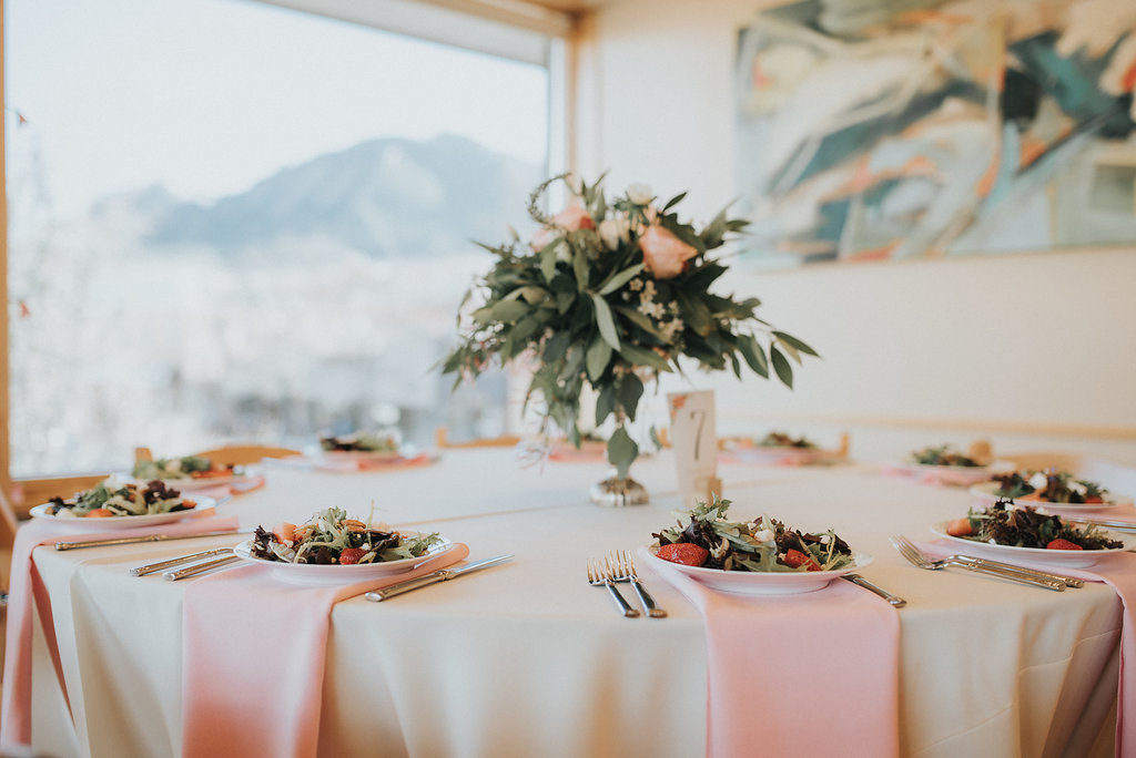 mountain backdrop wedding reception, table decor, floral centerpiece, plated salad, pink waterfall napkins, cream linens, colorado wedding coordination